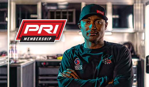 PRI Membership logo, NHRA Drag Racer Antron Brown crossing his arms