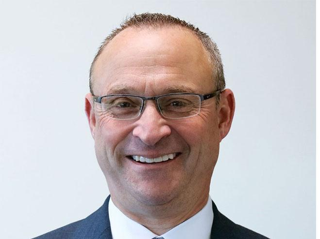 Headshot of Michael Buffamonti, new Dynabrade CEO, and Dynabrade logo