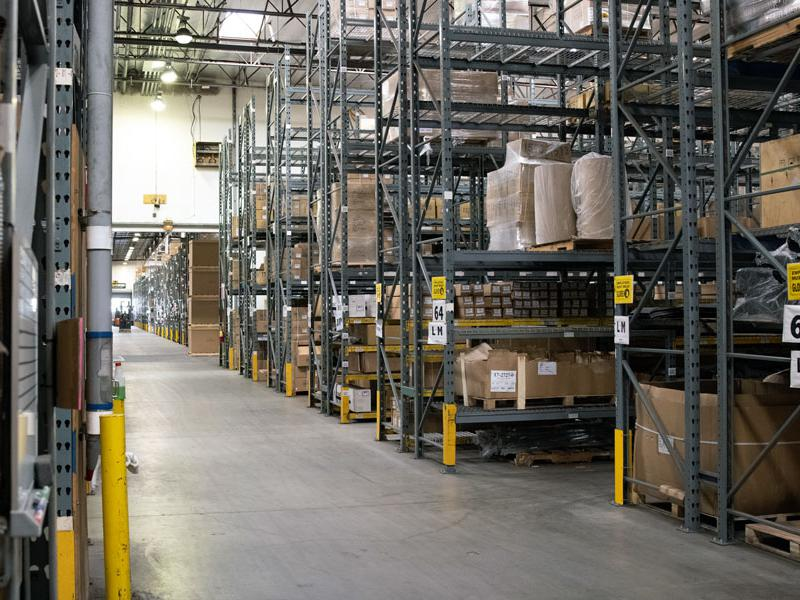 Image of EMPI's Anaheim, California warehouse with rows of shelves and boxes